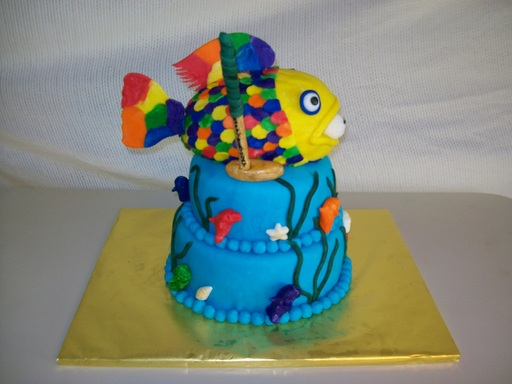 Rainbow fish with golfball and golf club cake